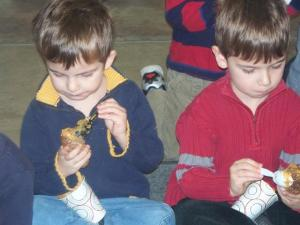 Brothers Charlie and Sam hard at work on their birdfeeders.